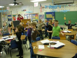 1st graders showing off their muscles