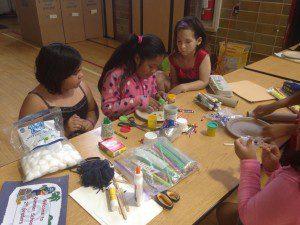 Summer school students work on creating their rabbit-free gardens.