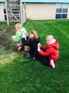 "Turkey Valley 3rd grade students using the garden to make observations about their common core topic - ""living things."""